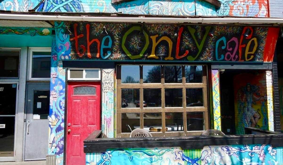 The colorful exterior of The Only Backpacker's Inn in Toronto, Canada